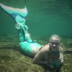 mermaid underwater reading